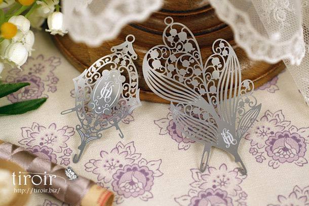 切り絵のように美しい繊細なすずらんやAnanoさんのロゴを配した、クロバー の糸通し、スレダー。(ポルトボヌール)